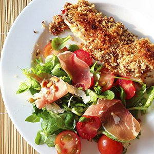 Pangasius with a crust and a salad.