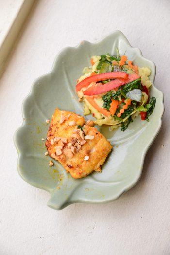 Green mango salad with char grilled panga fish
