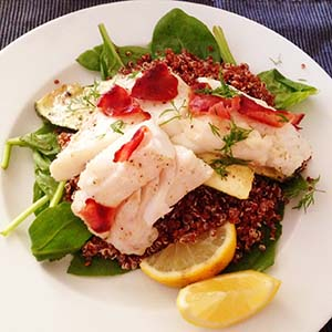 Recipe for Pangasius on a bed of spinach with quinoa and zucchini